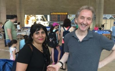 Neda Amin is welcomed by Times of Israel's David Horovitz at Ben-Gurion Airport, August 10, 2017. Times of Israel