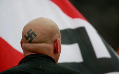 Neo-Nazi protesters organized by the National Socialist Movement demonstrating near where the grand opening ceremonies were held for the Illinois Holocaust Museum & Education Center in Skokie, Ill., April 19, 2009. (Scott Olson/Getty Images)