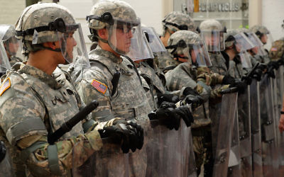 Members of the Virginia National Guard on the pedestrian mall in Charlottesville, Va., following violence at the United the Right rally, Aug. 12, 2017.  Getty Images