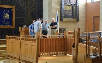 Texas GOP Sen. John Cornyn, right, during a Labor Day visit to the damaged sanctuary of United Orthodox Synagogue in Houston. Courtesy of JCRC-NY
