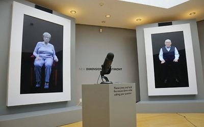 Holocaust survivors Eva Schloss, left, Anne Frank's posthumous stepsister when her mother married Frank's father, and fellow survivor Pinchas Gutter are displayed as part of an exhibit at the Museum of Jewish Heritage called 'New Dimensions in Testimony,' in New York, September 15, 2017. (AP Photo/Bebeto Matthews)