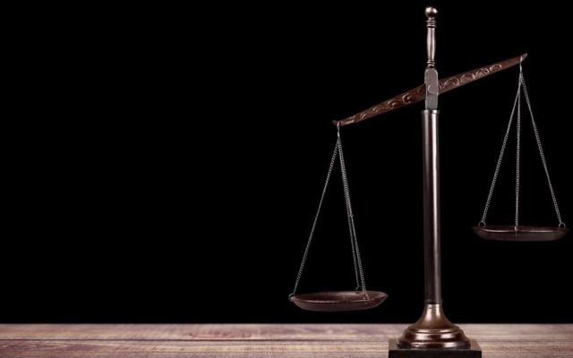 Scales of justice, Adobe Stock Photo.