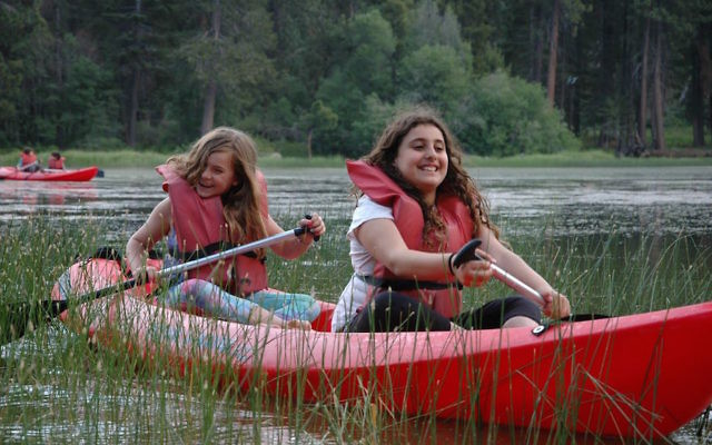 Illustrative photo of campers kayaking at a Jewish summer camp - Camp Gilboa near Los Angeles. JTA