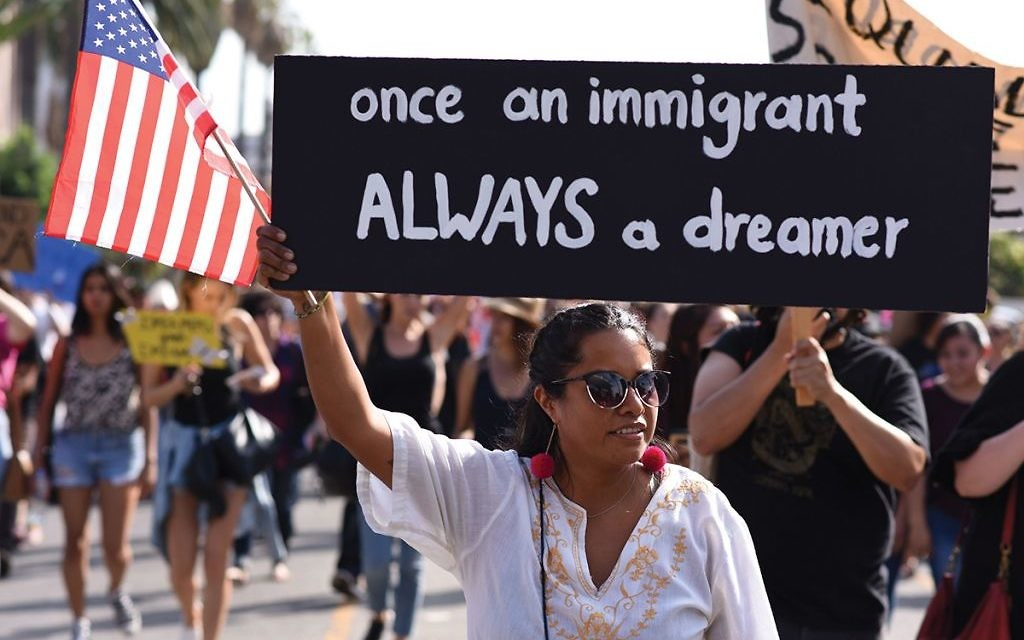 """Protestors in Los Angeles rally against efforts by the Trump administration to phase out DACA (Deferred Action for Childhood Arrivals). The plight of the so-called """"Dreamers"""" is resonating in the Jewish community. ROBYN BECK/AFP/Getty Images"""