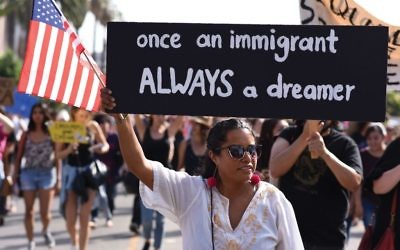 "Protestors in Los Angeles rally against efforts by the Trump administration to phase out DACA (Deferred Action for Childhood Arrivals). The plight of the so-called ""Dreamers"" is resonating in the Jewish community. ROBYN BECK/AFP/Getty Images"