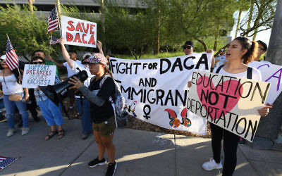 Immigrants and DACA supporters rallying across the street from the Trump International Hotel & Tower in Las Vegas, Sept. 10, 2017. (Ethan Miller/Getty Images)