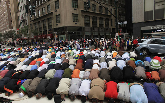 People praying before the start of the Muslim Day Parade in New York City, Sept. 26, 2010. Getty Images