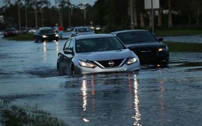 Cars make their away through a flooded street the morning after Hurricane Irma swept through the area on September 11, 2017 in Bonita Springs, Florida. Hurricane Irma made another landfall near Naples yesterday after inundating the Florida Keys. Getty Images