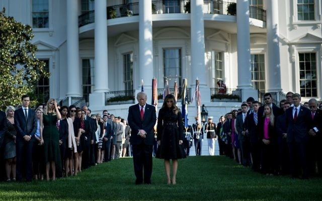 US President Donald Trump, US first lady Melania Trump and others participate in a moment of silence on the South Lawn of the White House during a memorial service for the 9/11 terrorist attacks September 11, 2017 in Washington, DC. Getty Images