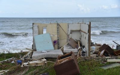 A picture taken on September 28, 2017 shows a house destroyed by Hurricane Maria in Yabucoa, in the eastern part of storm-battered Puerto Rico. Getty Images