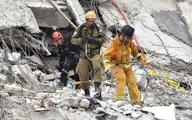 Israeli rescuers searching for survivors in a building flattened by an earthquake in Mexico City, Sept. 21, 2017. Getty Images