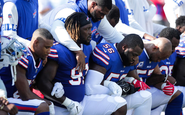Members of the Buffalo Bills kneeling during the national anthem before their game against the Denver Broncos at New Era Field in Orchard Park, New York, Sept. 24, 2017. (Brett Carlsen/Getty Images)
