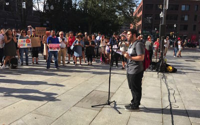 Elias Rosenfeld, a sophomore at Brandeis University, speaking at a rally at Boston's Faneuil Hall hours after President Trump announced he was rescinding DACA protections for some 800,000 young people, Sept. 5, 2017. (Jeremy Burton/JCRC of Greater Boston)