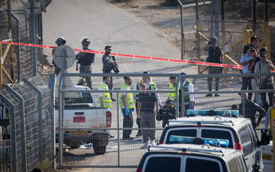 Israeli security at the scene where a Palestinian terrorist opened fire on israelis at the Har Adar settlement, outside of Jerusalem, killing three., and seriously injuring one. September 26, 2017. JTA