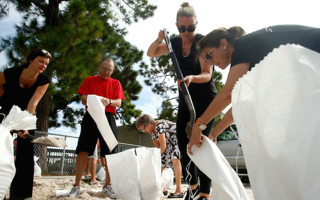 Floridians in Tampa filling sandbags to prepare for Hurricane Irma, Sept. 5, 2017. (Brian Blanco/Getty Images)