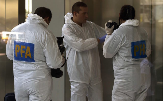 Forensic scientists of the Argentine Federal Police at the Buenos Aires apartment complex where special prosecutor Alberto Nisman was found dead, Feb. 13, 2015. JTA