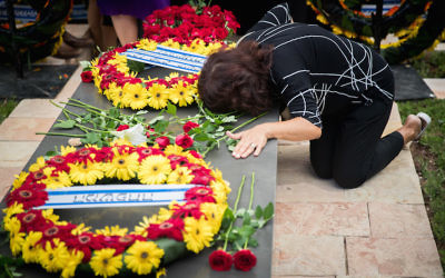 People pay their respects near the grave of late former President Shimon Peres during a ceremony marking one year since the death at Mount Herzl Cemetery in Jerusalem, on September 14, 2017. Peres passed away on September 28, 2016, after suffering from a stroke at the age of 93. JTA