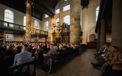 Concertgoers enjoying jazz music at Amsterdam's Portuguese Synagogue, Aug. 17, 2017. (Cnaan Liphshiz)