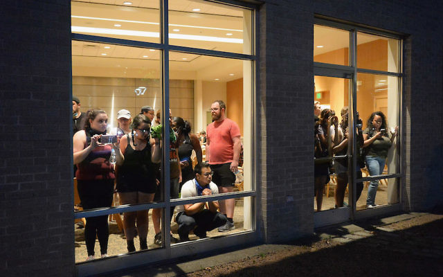 ST. LOUIS, MO - SEPTEMBER 15: Protestors take shelter in the Central Reform Jewish Congregation Center amid a protest action following a not guilty verdict on September 15, 2017 in St. Louis, Missouri. Protests erupted today following the acquittal of former St. Louis police officer Jason Stockley, who was charged with first-degree murder last year in the shooting death of motorist Anthony Lamar Smith in 2011. (Photo by Michael B. Thomas/Getty Images)