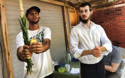 Chabad, which brings the sukkah experience to unaffiliated, including above, in Frisco, Texas, will soon bring the holiday hut to JFK.  CHABAD OF FRISCO VIA FACEBOOK