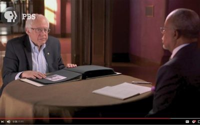 "Sen. Bernie Sanders with Henry Louis Gates during an upcoming episode of PBS' ""Finding Your Roots."" Screen shot from pbs.org"