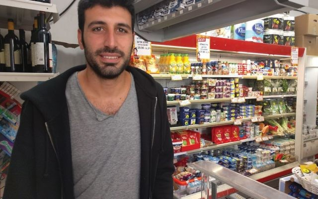 Tel Aviv convenience store partner Ron Hogeg says that business on Saturday generates a nice profit. Joshua Mitnick/JW
