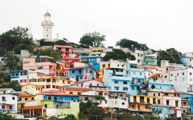 Las Peñas, the oldest quarter of Guayaquil, with its pastel-hued homes set on a hillside. Photos by Wikimedia Commons