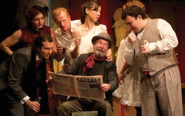 Nicolae Botezatu, sitting, with the rest of the cast of Romania's Jewish State Theater last year Courtesy of Jewish State Theater