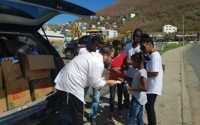 Rabbi Asher Federman of Chabad of the Virgin Island dispensing relief supplies on the hard-hit island. Courtesy of Chabad of the Virgin Islands