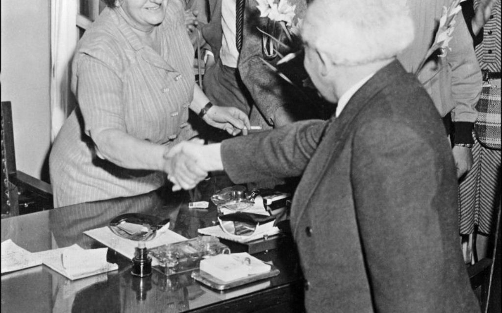 David Ben-Gurion, leader of Labour party (Mapai) shakes hand in December 1947 in Tel Aviv with Mrs Golda Meir. Israel was founded 14 May 1948 by the Jewish National Council. Getty Images
