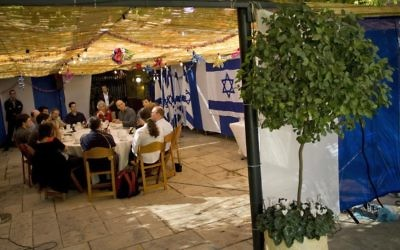 A sukkah at the Israeli Prime Minister's residence in Jerusalem in  2008. Sukkot, or The Feast of Tabernacles, celebrates one of Judaism's three great pilgrimage festivals and is considered a time to celebrate the harvest and pray for rain for the coming season. Getty Images