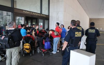 Disabled protesters block the entrance to the Health and Human Services headquarters located at the Hubert H. Humphrey Building on September 26, 2017 in Washington, DC. Getty Images