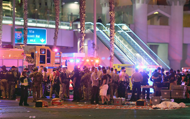 Police and rescue personnel at the intersection of Las Vegas Boulevard and Tropicana Ave after a shooting at a country music festival in Las Vegas, Oct. 2, 2017. (Ethan Miller/Getty Images)