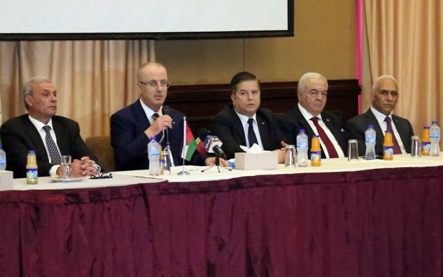 Palestinian prime minister Rami Hamdallah (C-L) attends a meeting with members Palestinian political groups, in Gaza city on October 4, 2017 prior to the Cairo talks. GettyImages