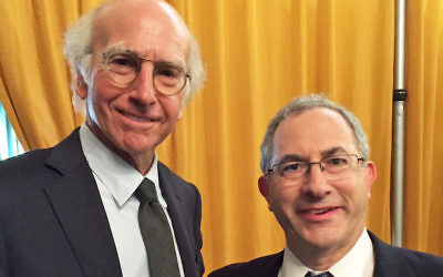"Cantor Kenny Ellis posing with ""Curb Your Enthusiasm"" creator Larry David. JTA"