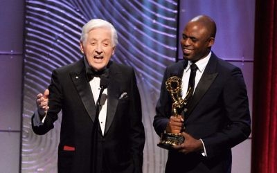 """Monty Hall receives the Lifetime Achievement Award onstage during The 40th Annual Daytime Emmy Awardson June 16, 2013 from Wayne Brady, current host of the game show """"Let's Make a Deal."""" JTA"""