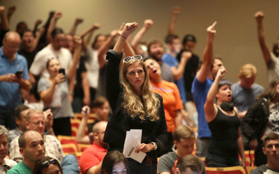 GAINESVILLE, FL - OCTOBER 19:  People react as white nationalist Richard Spencer, who popularized the term Ôalt-rightÕ speaks at the Curtis M. Phillips Center for the Performing Arts on October 19, 2017 in Gainesville, Florida. (Photo by Joe Raedle/Getty Images)