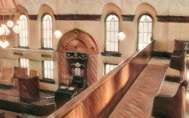 View over the Mechitza from the women's balcony of the B'nai Jacob Synagogue (Ottumwa, Iowa). Courtesy of JOFA.
