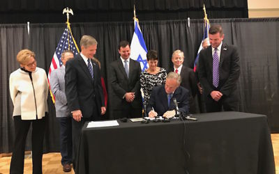 Texas Gov. Greg Abbott signing his state's anti-BDS bill at a Jewish community center in Austin, May 2, 2017. (Office of the Texas Governor)