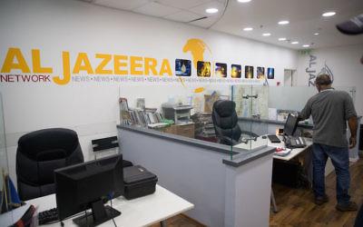Workers at the Al Jazeera offices in Jerusalem, June 13, 2017. (Yonatan Sindel/Flash90)