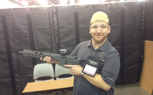 Jonathan Burstyn, a Jewish gun instructor, at an NRA convention, August 2017. (Courtesy of Burstyn)
