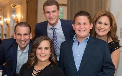 Jason Mendelsohn, left, with his family. Studio T Photography