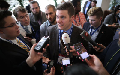"NATIONAL HARBOR, MD - FEBRUARY 23:  Reporters surround white supremacist Richard Spencer during the first day of the Conservative Political Action Conference at the Gaylord National Resort and Convention Center February 23, 2017 in National Harbor, Maryland. American Conservative Union Chairman Matt Schlapp said that Spencer was ""not part of the agenda"" at CPAC. Hosted by the American Conservative Union, CPAC is an annual gathering of right wing politicians, commentators and their supporters.  (Photo by Chip Somodevilla/Getty Images)"