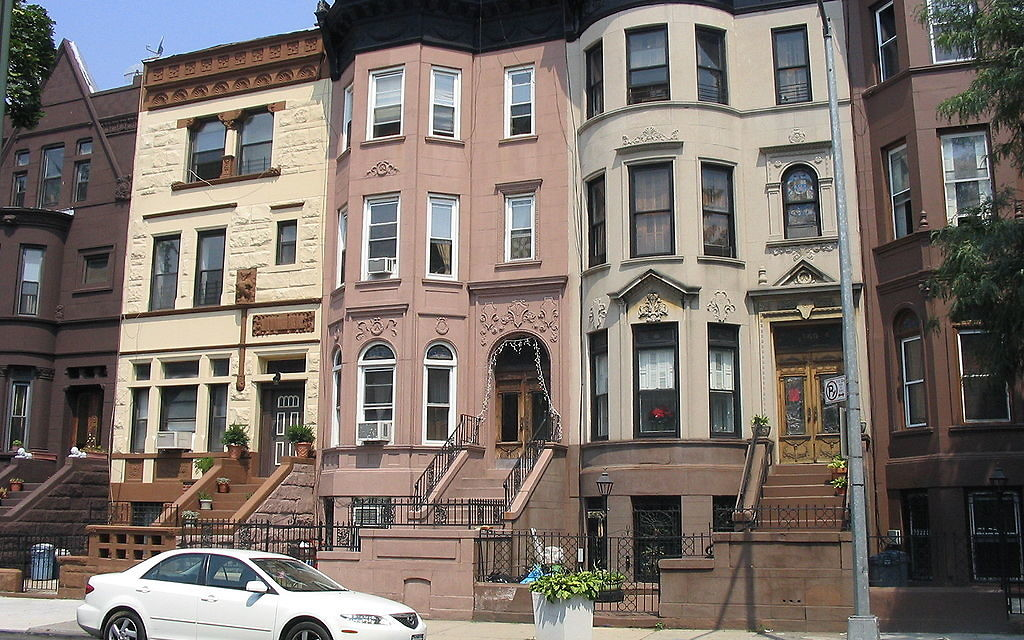 Brownstones on a street in Bed-Stuy. Wikimedia Commons