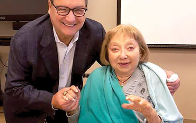 """Abraham Foxman, a fellow survivor of the Holocaust, said Fanya Gottesfeld Heller """"always had a smile, a witty thing to say."""" They were pictured here last July at a Museum of Jewish Heritage event for teachers. PHOTO COURTESY OF ABRAHAM FOXMAN"""