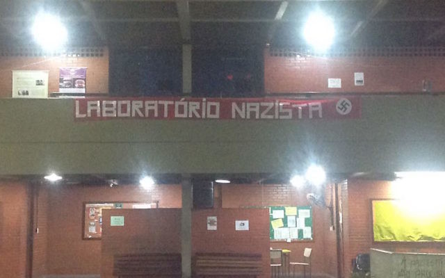 "A banner reading ""Nazi laboratory"" hanging at the Milecimo da Silva high school in Rio De Janeiro, Brazil. (Screenshot from Facebook)"