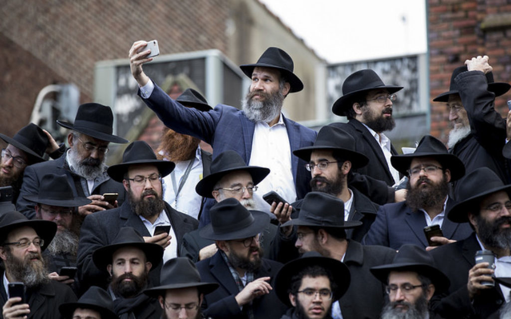 Thousands of rabbis pose for a group photo in front of Chabad-Lubavitch world headquarters in the Brooklyn borough of New York, Sunday, Nov. 19, 2017. Courtesy of Mendel Grossbaum/Chabad.org