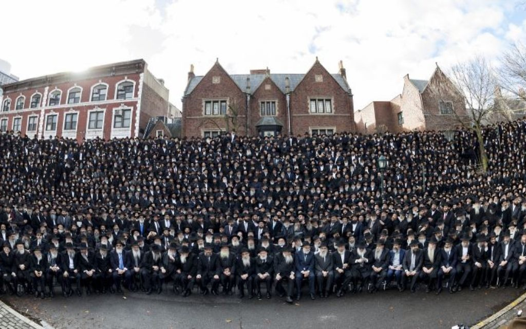 Thousands of rabbis pose for a group photo in front of Chabad-Lubavitch world headquarters in the Brooklyn borough of New York, Sunday, Nov. 19, 2017. It's a feat of coordination, engineering and technology to fit all the attendees in the photo. Courtesy of Mendel Grossbaum/Chabad.org