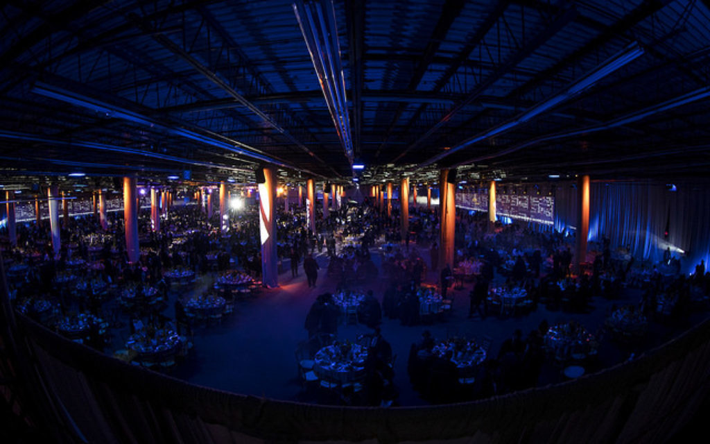 Rabbis mill around tables set up for a gala dinner at the International Conference of Chabad-Lubavitch Emissaries in Bayonne, New Jersey on Nov. 19, 2017. They were among 5,600 rabbis and guests from 90 countries in New York for the conference. Courtesy of Mendel Grossbaum/Chabad.org