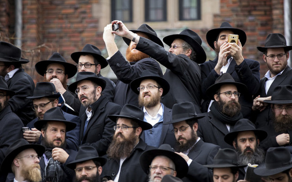 Rabbis are seen among a sea of black hats as they pose for a group photo in front of Chabad-Lubavitch world headquarters in the Brooklyn borough of New York, Sunday, Nov. 19, 2017. Courtesy of Mendel Grossbaum/Chabad.org